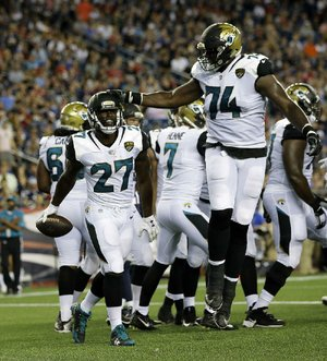 Jacksonville Jaguars running back Leonard Fournette (27) thought the speed of Thursday night's exhibition game against the New England Patriots was not as fast as what he saw when he was playing at LSU.