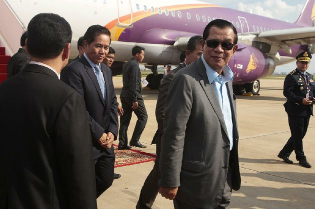 cambodian-prime-minister-hun-sen-center-arrives-at-the-airport-saturday-in-phnom-penh-after-a-quick-trip-to-laos-for-talks-with-laotian-prime-minister-thongloun-sisoulith