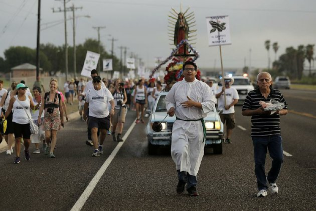 altar-server-anthoney-saenz-second-from-right-waves-incense-saturday-as-he-helps-lead-a-procession-toward-the-rio-grande-to-oppose-the-wall-the-us-wants-to-build-at-the-mexican-border