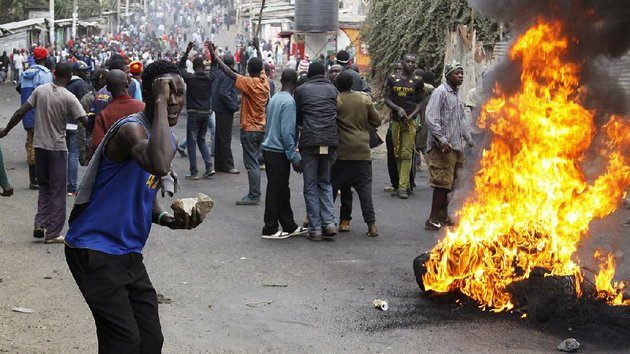 backers-of-kenyan-opposition-leader-raila-odinga-block-a-road-with-fiery-barricades-saturday-in-the-kibera-slum-area-of-nairobi-in-protest-of-tuesdays-election-results-that-show-president-uhuru-kenyatta-winning-re-election-police-used-live-ammunition-against-rioters-in-kibera-and-fired-tear-gas-at-vehicles-carrying-opposition-leaders-trying-to-enter-the-slum
