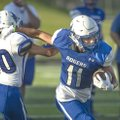 Rogers High junior Will Sims (11) breaks away from sophomore teammate Vincent Vo on Friday during pr...