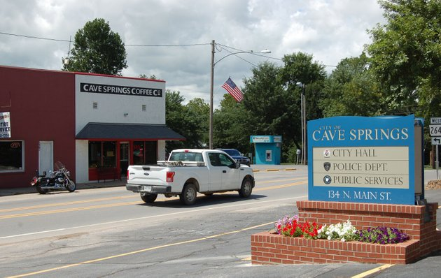 nwa-democrat-gazettestacy-ryburn-traffic-moves-along-main-street-friday-in-cave-springs