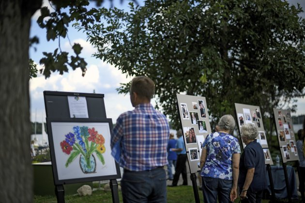 photos-of-justine-damond-and-artwork-inspired-by-her-are-displayed-during-her-memorial-service-friday-aug-11-2017-at-lake-harriet-in-minneapolis-damond-was-killed-by-a-minneapolis-police-officer-on-july-15-after-she-called-911-to-report-a-possible-sexual-assault-near-her-home-aaron-lavinskystar-tribune-via-ap