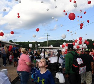 The Sentinel-Record/Mara Kuhn Students, employees and members of the Mountain Pine community gathered Thursday evening for the yearly practice of releasing balloons in celebration of the 17th annual Dr. Morriss Memorial Carnival on campus. Students throughout Garland County will return to campus on Monday for the first day of the 2017-18 school year.