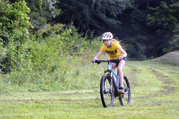 nwa-democrat-gazettespencer-tirey-cate-mertins-of-haas-hall-academy-practices-with-her-nica-mountain-biking-team-thursday-july-13-2017-at-slaughter-pen-mountain-biking-trail-in-bentonville-mountain-biking-has-exploded-in-northwest-arkansas-as-well-as-across-the-state-more-than-20-nica-teams-including-a-host-of-single-school-teams-across-the-state-will-compete-in-the-second-year-of-the-program