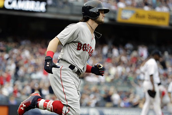 Boston Red Sox's Andrew Benintendi runs the bases after hitting a after hitting a three-run home run during the fifth inning of a baseball game against the New York Yankees, Saturday, Aug. 12, 2017, in New York. (AP Photo/Frank Franklin II)