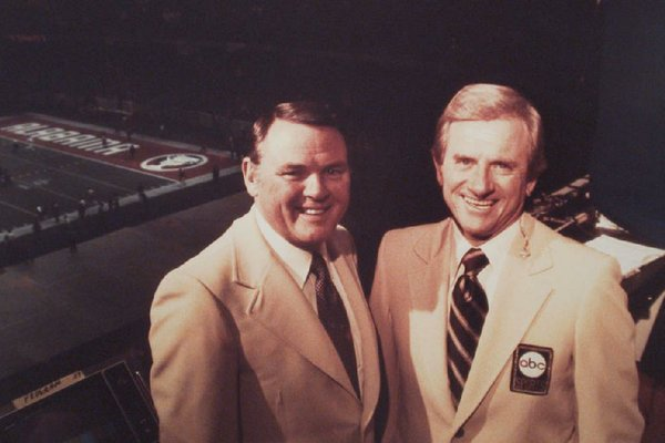 Frank Broyles (right) and broadcaster Keith Jackson began working as a team on ABC college football telecasts after Broyles retired as the Razorbacks coach in 1976.