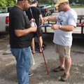 Arthur White (left) rigs a cane pole for fishing at Lake Fayetteville. White opted to fish from shor...