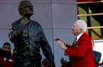 Frank Broyles admires the statue representing him during an unveiling ceremony outside the Broyles Athletic Center on Friday, Nov. 23, 2012, at Donald W. Reyonlds Stadium in Fayetteville.