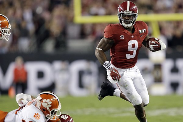 Alabama's Bo Scarbrough runs for a touchdown during the first half of the NCAA college football playoff championship game against Clemson Monday, Jan. 9, 2017, in Tampa, Fla. (AP Photo/Chris O'Meara)