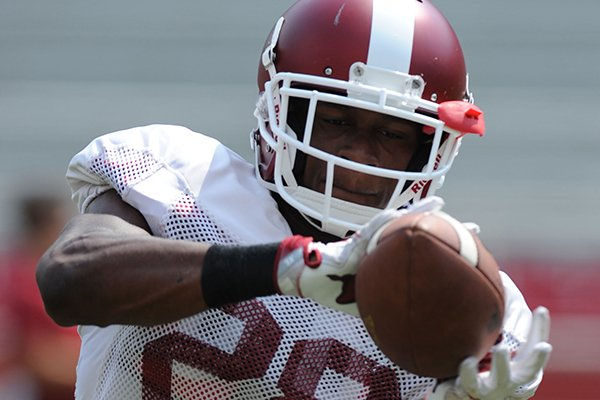 Arkansas defensive back Josh Liddell makes a catch Saturday, Aug. 5, 2017, prior to the start of a scrimmage in Razorback Stadium in Fayetteville.