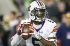 Auburn quarterback John Franklin III (5) drops back to pass against Alabama during the second half of the Iron Bowl NCAA college football game, Saturday, Nov. 26, 2016, in Tuscaloosa, Ala. (AP Photo/Butch Dill)