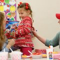 Ruby Seay laughs as she makes a strawberry shortcake Feb. 14 with Jessica Luckett (left) with the Ar...