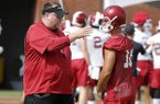 Arkansas coach Bret Bielema talks with punter Blake Johnson during practice Friday, July 28, 2017, in Fayetteville.