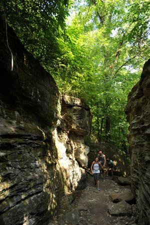 Residents hike through Rock City along the trail on Mount Kessler in Fayetteville.