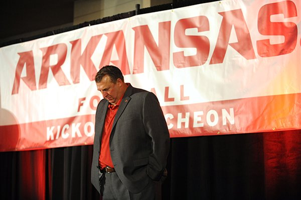 Arkansas coach Bret Bielema joins others in a moment of silence Friday, Aug. 18, 2017, for former coach and athletics director Frank Broyles, who died Monday, during the Kickoff Luncheon at the Northwest Arkansas Convention Center in Springdale.
