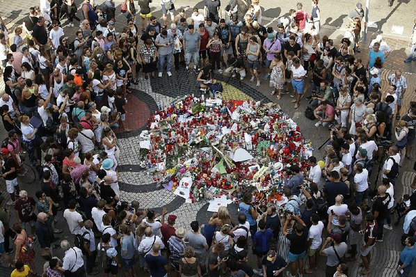 Man arrested after van ploughs into crowd in Barcelona