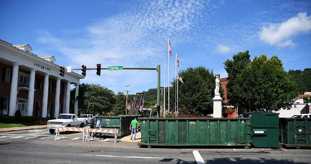 hot-springs-sanitation-workers-place-large-trash-bins-around-a-confederate-memorial-on-friday-ahead-of-a-rally-today