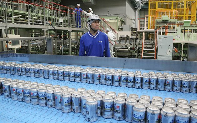 asahi-breweries-plant-manager-shinichi-uno-watches-the-production-line-at-an-asahi-breweries-factory-in-moriya-near-tokyo-in-late-may