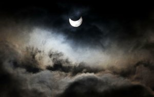 A partial solar eclipse was seen from Gaza City in 2011. On Monday, a solar eclipse will cross America for the first time in 99 years, and believers across all faiths will put into practice different eclipse traditions.