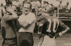 Arkansas coach Frank Broyles (center) and quarterback Bill Montgomery (10) interact with an unidentified assistant coach during a 1969 game in Little Rock.