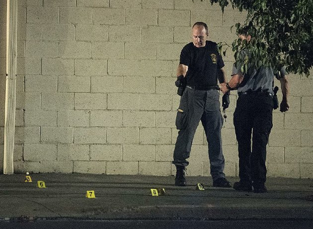 a-police-forensics-team-searches-for-and-tags-evidence-friday-in-fairchance-pa-where-two-state-troopers-were-shot