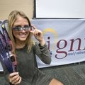 Hailey Brown, a Bentonville High senior, poses with solar eclipse viewing glasses Friday at Bentonvi...