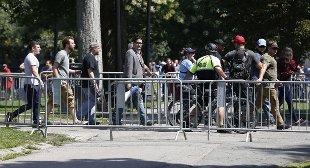 organizers-depart-a-quotfree-speechquot-rally-staged-by-conservative-activists-on-boston-common-saturday-aug-19-2017-in-boston-one-of-the-planned-speakers-of-a-conservative-activist-rally-that-appeared-to-end-shortly-after-it-began-says-the-event-quotfell-apartquot-dozens-of-rallygoers-gathered-saturday-on-boston-common-but-then-left-less-than-an-hour-after-the-event-was-getting-underway-thousands-of-counterprotesters-had-also-gathered-ap-photomichael-dwyer