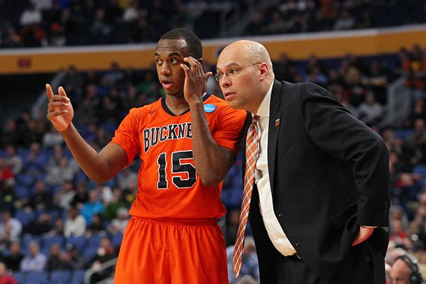 Bucknell Bison guard Nate Jones (15) talks to Bucknell Bison head coach Nathan Davis during the second half of a first-round men's college basketball game against the West Virginia Mountaineers in the NCAA Tournament, Thursday, March 16, 2017, in Buffalo, N.Y. West Virginia won, 86-80. (AP Photo/Bill Wippert)