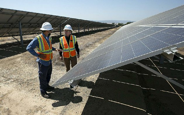 solar-tech-joshua-valdez-left-and-senior-plant-manager-tim-wisdom-confer-after-a-walk-through-of-a-pacific-gas-and-electric-solar-plant-on-thursday-in-vacaville-calif