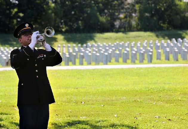 bugler-cadet-justin-karp-plays-taps-during-the-funeral-service-friday-for-audrey-straight-wolfe-jr-at-the-arkansas-state-veterans-cemetery-at-north-little-rock-officials-are-looking-into-expanding-burial-space-at-the-cemetery-after-a-recent-uptick-in-burials