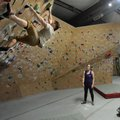 Jason Groves (from left), co-owner of Ozark Climbing Gym in Springdale, climbs Friday on one of the ...