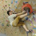 Jason Groves, co-owner of Ozark Climbing Gym in Springdale, climbs Friday on one of the gym's three ...