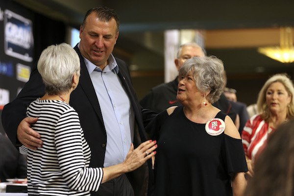 Arkansas Razorbacks head coach Bret Bielema (left center) meets with fans before speaking to the Little Rock Touchdown Club on Monday, Aug. 21, 2017, at the Embassy Suites hotel in Little Rock.