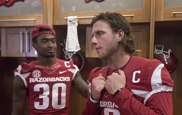 Kevin Richardson (30), senior defensive back from Jacksonville, and Austin Allen, senior quarterback from Fayetteville, talk to the press in the locker room Saturday, Aug. 5, 2017, during Arkansas football media day at the Fred W. Smith Football Center in Fayetteville.