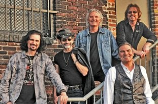 Submitted photo AMERICAN BAND: Grand Funk Railroad will perform on Friday, March 16, 2018, the night before the First Ever 15th Annual World's Shortest St. Patrick's Day Parade on Bridge Street.