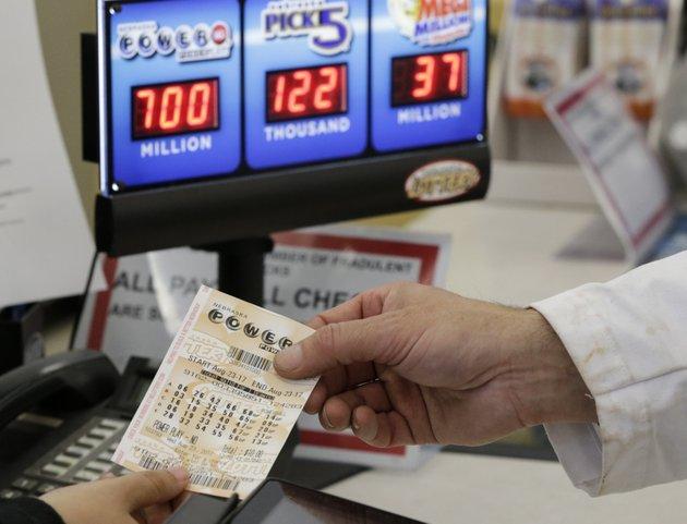 a-customer-is-handed-a-powerball-ticket-in-omaha-neb-wednesday-aug-23-2017-ap-photonati-harnik