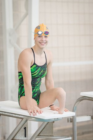 Julia Gaffney of Mayflower, a double congenital amputee, gets ready to practice with the Hendrix Aquakids in Conway. The 17-year-old has been selected to represent Team USA at the 2017 World Para Swimming Championships in Mexico City from Sept. 30 to Oct. 6.