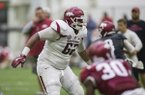 Arkansas offensive guard Johnny Gibson goes through practice Saturday, April 29, 2017, in Fayetteville.