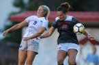 Arkansas' Jessi Hartzler (15) and Penn State's Frannie Crouse (9) leap to head the ball Friday, Aug. 25, 2017, during the Razorbacks' 4-2 loss at Razorback Field in Fayetteville.