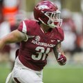 Redshirt freshman Grant Morgan works during Arkansas football practice on Saturday, April 29, 2017, ...