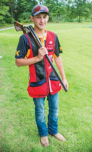 Roe Reynolds, 17, a senior at Quitman High School, poses with his Krieghoff K-80 12-gauge at Wooster International Shooting Park, owned by Tommy Browning and his daughter, Kayle Browning Thomas, who coach Reynolds. Reynolds won a nail-biter in Colorado Springs, Co., in July to qualify for the USA Shooting World Championship shotgun team. He will travel to Moscow on Sept. 1-10 to compete.