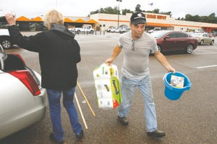 Donations: Kenny Dougan carries supplies from an anonymous donor. The supplies are for victims of Hurricane Harvey.