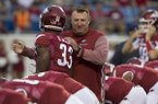 Arkansas coach Bret Bielema, right, talks with running back David Williams prior to a game against Florida A&M on Thursday, Aug. 31, 2017, in Little Rock.