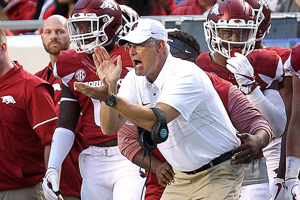 Arkansas defensive coordinator Paul Rhoads encourages his players during a game against Florida A&M on Thursday, Aug. 31, 2017, in Little Rock.
