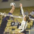 Bentonville High's Emma Palasak (right) spikes a ball through the hands of Fayetteville's Ella May P...