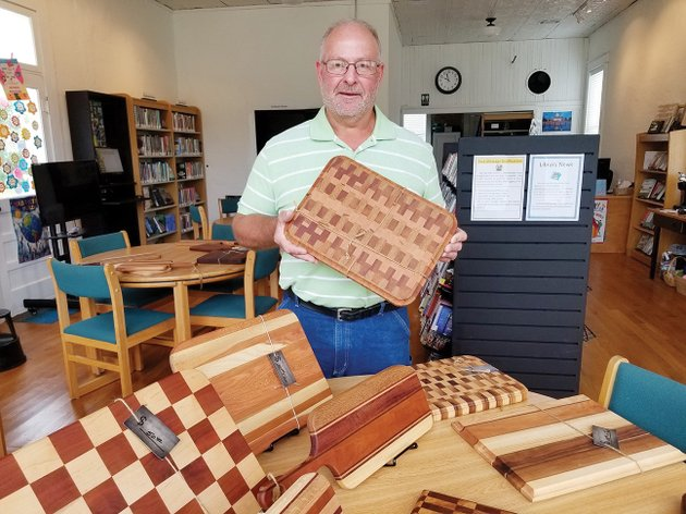 steve-shock-a-retired-teacher-and-coach-in-the-vilonia-school-district-stands-in-the-el-paso-community-library-with-his-handmade-wooden-cutting-boards-his-work-is-on-display-at-the-library-during-september-as-part-of-the-artist-of-the-month-program