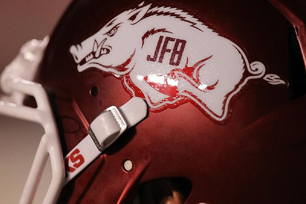 A helmet with the initials of longtime Arkansas coach and athletics director Frank Broyles is shown during a game against Florida A&M on Thursday, Aug. 31, 2017, in Little Rock.