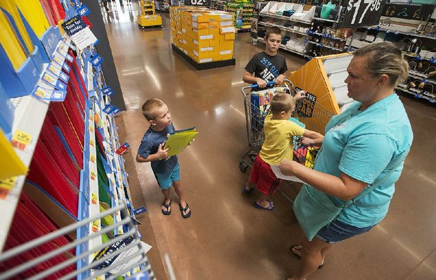 jenny-berry-of-rogers-shops-for-school-supplies-with-her-sons-cole-10-and-6-year-old-twins-taylor-and-brayden-in-august-at-the-wal-mart-supercenter-in-rogersthe-retail-giant-is-revising-its-product-delivery-requirements-to-keep-its-shelves-full