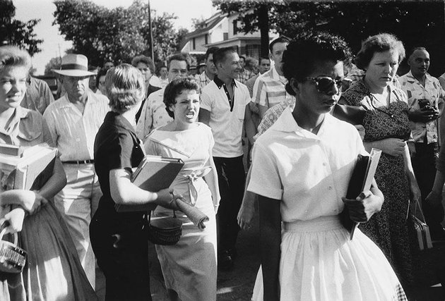 hazel-bryan-shouts-insults-at-elizabeth-eckford-as-she-walks-past-a-line-of-national-guardsman